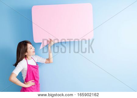 beauty housewife take speech bubble billboard and smile isolated on blue background