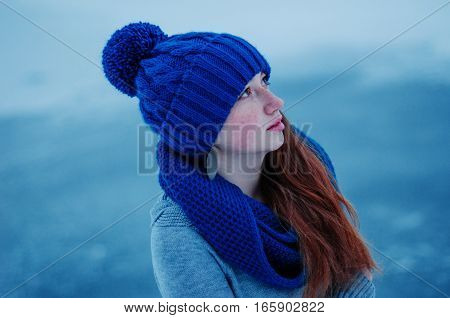 Portrait Of Young Red Hair Girl With Freckles Wearing At Blue Knitted Wool Hat And Scarf In Winter D