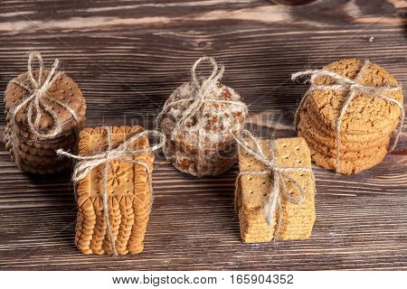 Biscuits tied with string on old wooden table