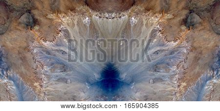Effects of erosion on desert stones, symmetrical photographs of landscapes of the deserts of Africa from the air,