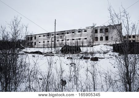 Exterior of old decayed abandoned prison in Kolyma