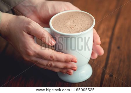 Female Hands Tenderly Holding Cup Of Cacao