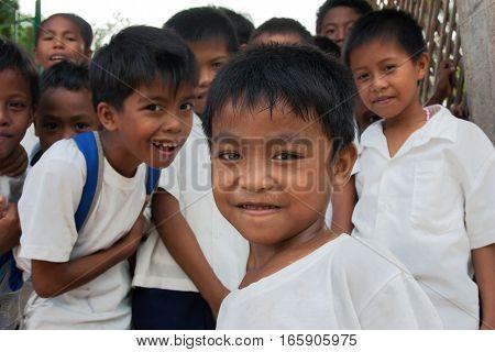POPOTOTAN ISLAND PHILIPPINES - JANUARY 162012: School children walk on the break