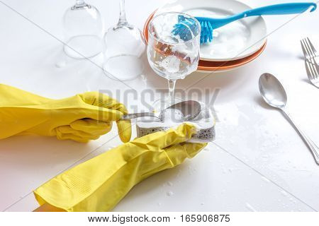 concept of woman washing dishes on white background with hands