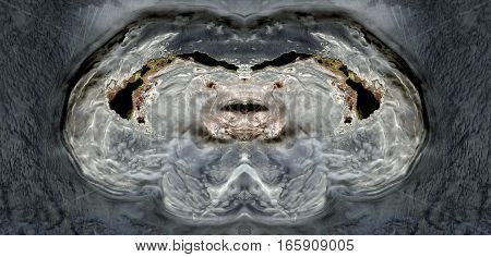 Effects of erosion on the black sands of the desert creating as a vulva, symmetrical photographs of landscapes of the deserts of Africa from the air,