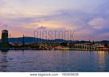 Rambla de Mar Port Vell at Sunset. Beautiful peaceful view Barcelona, Catalunya Spain poster