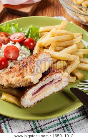 Cutlet Cordon Bleu With Pork Loin Served With French Fries And Salad