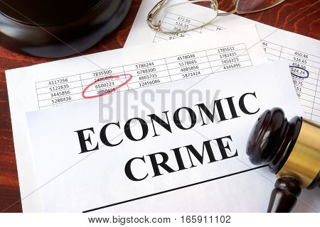 Documents with title Economic crime and a gavel.