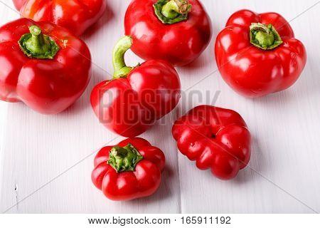 Pepper ratunda ( gogoshar ). Tomato shaped sweet pepper on white. Red bell pepper capsicum or sweet pepper.
