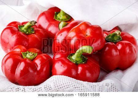 Pepper ratunda ( gogoshar ). Tomato shaped sweet pepper on white. Red bell pepper capsicum or sweet pepper.