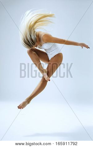 Woman dancer jump in studio on white background