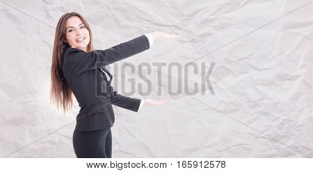 Joyful Female Manager Holding Something Big