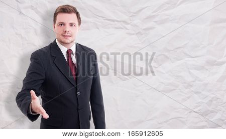 Nice Young Businessman Doing Welcoming Gesture
