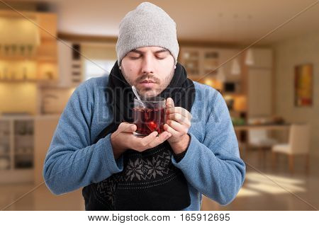 Sick Man Holding A Warm Cup Of Tea