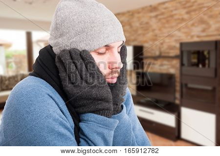 Close-up Of Sick Man In Winter Clothes