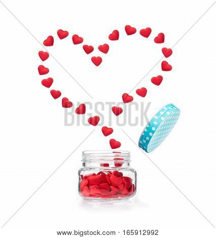 small red hearts flying out of glass jar pushing open the blue dotted lid forming big heart shape on isolated white background