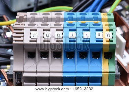 Power supply electrical terminals with cables close up