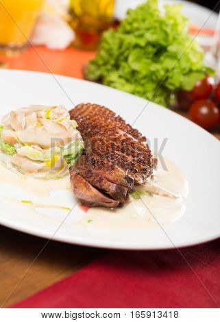 Roasted Duck With Pear Marinated In Red Wine And Mascarpone Rose