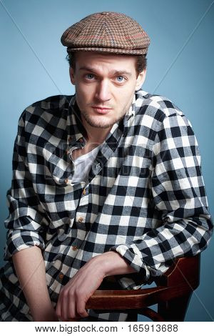 Portrait of a Young Man in a Checker Shirt and Cap.