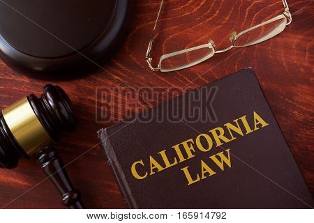 Book with title California law and a gavel.