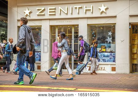 Hong Kong, China - December 6, 2016: Zenith store, luxury swiss watchmakers in Causeway Bay with tourists and business people looking for shopping. Asian common people in front of famous