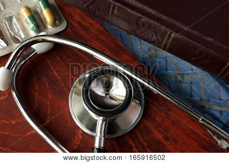 Stethoscope and book on a table. Medical education.