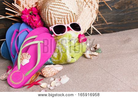 Flip Flops, Towel, Hat and Sunglasses on the Beach