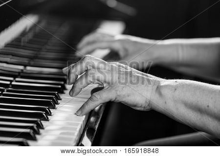 Hands of a genius. Close-up shoot of hands touching piano keys