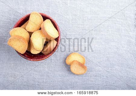 Slices Of Rusk In Old Wooden Bowl On Burlap