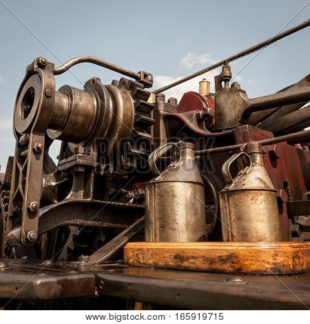 Close detail on the visible mechanism of an old English steam traction engine.
