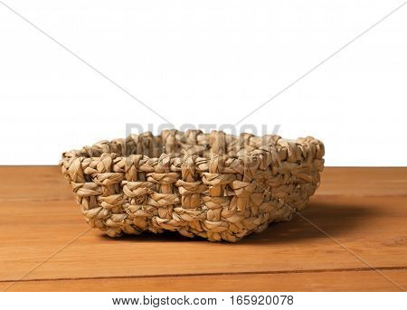 Empty basket on wooden deck table over grunge background