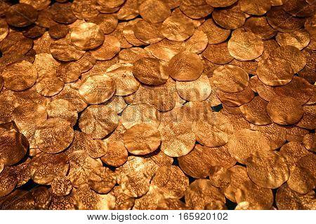 Full frame gold coin bullion background texture.