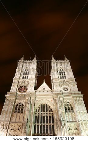 Westminster Abbey, London, UK. Low angle, night view of the façade to the popular London cathedral landmark.