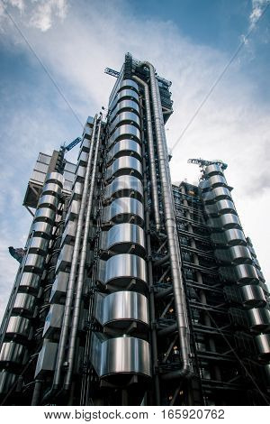 LONDON, UK - 5 APRIL 2010: Low angle full view of the iconic Lloyds building London. The building is a leading example of Bowellism architecture.