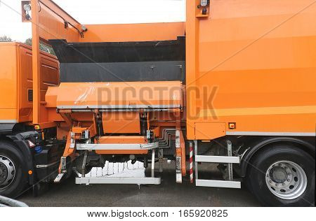 Municipal truck vehicle collecting garbage containers on the streets