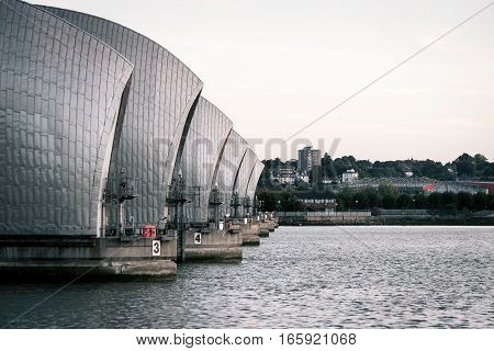 A view along the Thames flood barrier which runs across the river in East London.