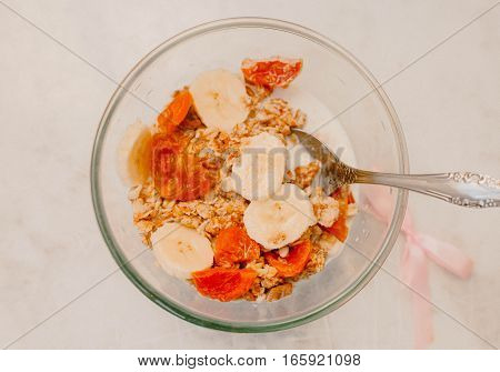 Granola with banana and Dried apricots in a bowl
