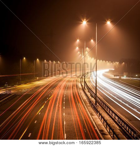Long exposure of a UK motorway with trails of light of passing vehicles.