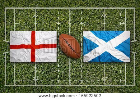 England vs. Scotland flags on green rugby field, 3d illustration