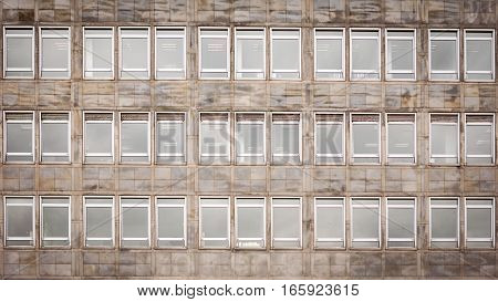 An anonymous office building with symmetry and rows of windows.