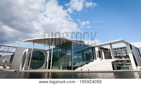 BERLIN GERMANY - JUNE 2 2006: A view of the Marie Elizabeth-Lunder building in Berlin Germany. The government building is used as a parliamentary library and archive and creates a futuristic landmark on the banks of the River Spree.