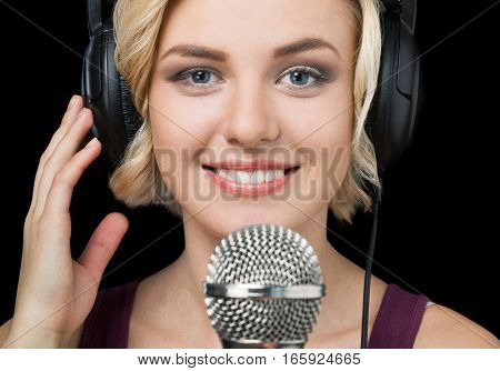 Closeup of a Woman with Headphones and Microphone
