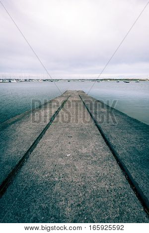 Boat slipway ramp at a small marina near Malahide Ireland.