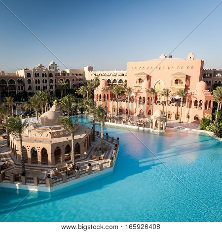 HURGHADA, EGYPT - NOVEMBER 22 2006: A wide and high view of a 5 star luxury hotel resort near Hurghada Egypt showing the main pool and restaurant.