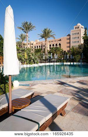 HURGHADA, EGYPT - NOVEMBER 22 2006: A poolside view at a luxury 5 star hotel resort near Hurghada Egypt.
