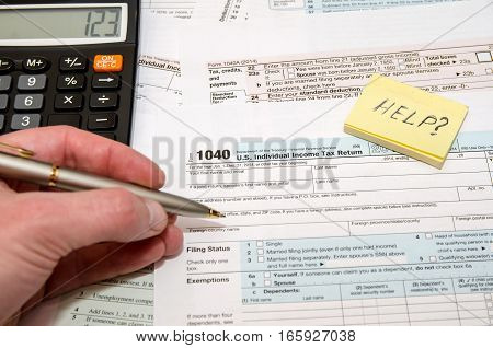 Tax Form 1040 U.S. Individual income tax return place with calculator and pen