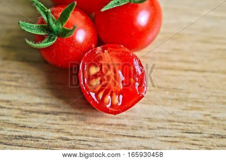 Closeup of ripe cherry tomatoes on a wooden table