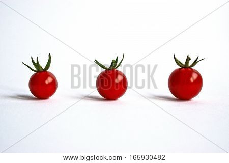Closeup of ripe cherry tomatoes on a white background
