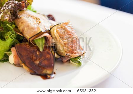 Closeup of a Salad with Ham and Aubergines