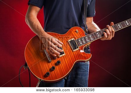 Closeup of a Musician Playing an Electric Guitar